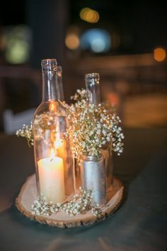 Love the pillar candles under the wine bottle (bottom cut out)....great for outdoor parties