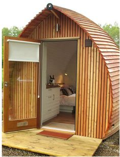 Loch Ness Armadillas: built out of sustainably harvested larchwood for a glamping resort in Scotland, sleeps two people and has a kitchen and bathroom with shower and flush toilet.