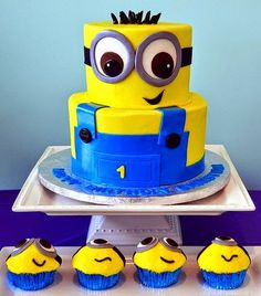 Despicable me minion tiered cake and cupcakes