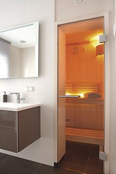 A state of the art bathroom is completed with a sauna. Sauna Room, Prefabricated Houses, Audio Room, Basement Bedrooms, Modern Room, Saunas, Small Bathroom, Bathroom Sinks, Sweet Home
