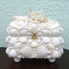 Lovely Seashell Box. This is easier to make than you might think! If you have mult-color shells, you could always paint them white!
