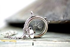 """The glass locket filled with real dandelion seeds is hanging on a long silver chain, with a small silver """"WISH"""" charm, so that all your dreams come trueGlass locket with REAL DANDELION seeds, amazing jewellery, unique accessories, long silver necklace - a unique product by VillaSorgenfrei via en.dawanda.com"""
