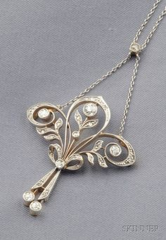 Edwardian Diamond Pendant, of scrolling foliate form, suspending drops, and set with old European, old single, and rose-cut diamonds, millegrain accents, platinum-topped gold mount, suspended from delicate trace link chain.