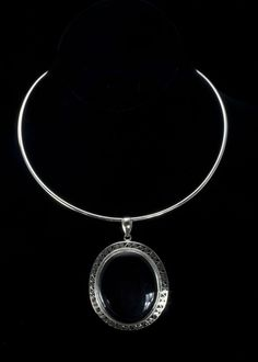 """Black Onyx Necklace  Large oval onyx stone 1-3/4""""""""L x 1-1/2""""""""W and is surrounded with filigree sterling silver. Pendant hangs on a solid sterling silver collar.   http://www.sterlingjewelrystores.com/product577.html"""