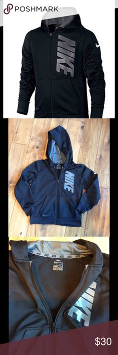 Nike Boys Therma Full Zip Hoodie in Black Nike provides breathable warmth for outdoor play with this lined, full coverage graphic print hoodie featuring a zippered closure for easy on and off. The Jacket has an attached hood, long sleeves and front pockets. Machine Washable. In perfect condition- only wore once! Nike Jackets & Coats
