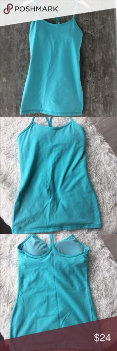 Lululemon tank with built in bra Light blue lululemon tank perfect for yoga. Built in bra for added comfort and original padding inserts still included. Only worn 3-5 times. Like new condition. lululemon athletica Tops Tank Tops