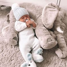 This elephant pillow made of only the highest quality plush materials. The soft and durable design makes it perfect for cuddling and Cotton is bound to make your baby smile at first touchHypoallergenic material to preve. So Cute Baby, Baby Kind, Cute Kids, Funny Babies, Cute Babies, Elephant Pillow, Baby Elephant Toy, Baby Smiles, Foto Baby