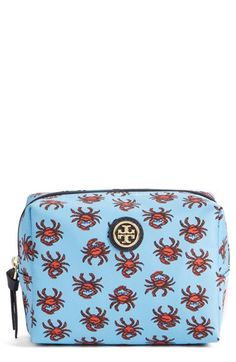 A playful print adds a nautical feel to this Tory Burch cosmetic case.