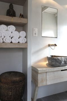 The textural element in this bathroom has the elements of an asian contemporary design. The material of this sink provides the earth element to the bathroom. The buddha figure is and the basket will be textural accessories.