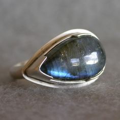 This ring is so me. Such a unique shape. Handmade Sterling Silver Labradorite Ring Teardrop by tkmetalarts, $158.00