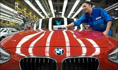 German automaker BMW said Tuesday that weaker demand from China could weigh on its full-year earnings, as it reported a slight drop in its second-quarter profits.