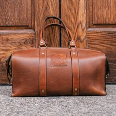 Introducing The 1933 Leather Duffle Bag. Hand made in the U.S.A with 100% American Leather and features bonded polyester thread for durability and is hand dressed and polished for smooth edges. Availa