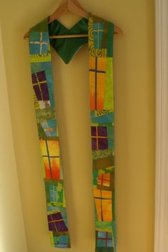 Here is a beautiful stole designed created by Vivika DeNegre for her pastor. The predominantly green color is used most during the liturgical year but I love how she has interspersed hits of orange, yellow, and purple in the design. Christian Symbols, Prayer Flags, Colorful Quilts, Church Banners, Sacred Art, Religious Art, Altered Art, Sewing Projects, Inspiration