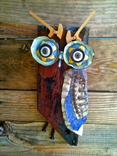 Reclaimed timber, leather, piano hammers, odds and ends ...   Bandsaw, hand drill, hammer, sander ...   All these owls have flown the co...