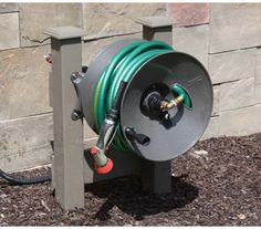 Wall Mount Garden Hose Reel - 150 ft - Rapid Reel but mounted on posts.  Love this idea for my garden.