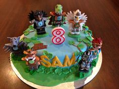 Lego Chima Cake - featuring 7 edible Chima characters going in to battle for Sam's 8th Birthday!