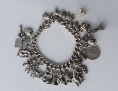 Silver Charm Bracelet with 24 Charms, 90.4 g . Vintage, Sterling Silver. Hallmarked on each Link by LittleVintageCharmCo on Etsy