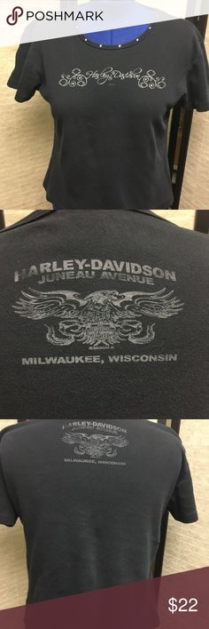 Harley-Davidson Shirt with 8 crystals H-D shirt with 8 crystals across the neckline. The front has Harley-Davidson scripted across the front with several Bar & Shields. The back has H-D Juneau Avenue, an Eagle, and Milwaukee, Wisconsin. Writing has faded due to normal wear.  Thank you for browsing my closet! If you have any questions, please ask before purchasing. Harley-Davidson Tops Tees - Short Sleeve