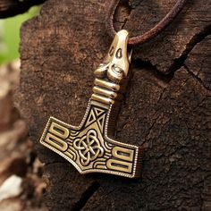 This is a real solid bronze 3-dimentional hand-crafted heavy antique finish pendant. The pendant is a replica of a one found around eleventh century A.D., as is shown on the last image. It is designed in the form of a Thors hammer, its boat shaped and has an avian head terminal. A Thors hammer, or Mjolnir, is a very powerful Nordic protective amulet, a symbol of the creative powers of man. It is a really powerful shield from any negative energy channeled towards the owner of the pendant and…