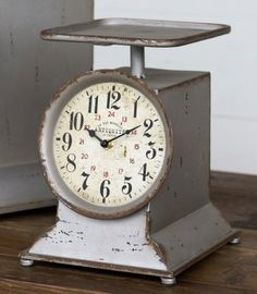 This cute Little Grocery Scale Clock is a smaller version of our super popular Grocery Scale Clock! It adds a lovely Farmhouse feel to any kitchen!