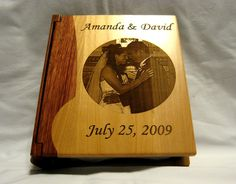 Have your favorite wedding photo engraved on the cover of this personalized wooden wedding photo album at whitetailwc.com.