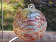 A personal favorite from my Etsy shop https://www.etsy.com/listing/270510784/handmade-glass-ornamentsuncatcher-red