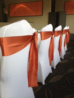Burnt Orange Sashes on White Spandex Chair Covers - Wedding Chairs
