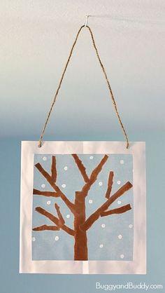 Winter Tree Suncatcher Craft for Kids using tear art and cotton swab painting- a fun winter art project for preschool, kindergarten, and elementary! ~ http://BuggyandBuddy.com