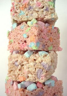Rice Krispies squares made with Lucky Charms. ross would love these
