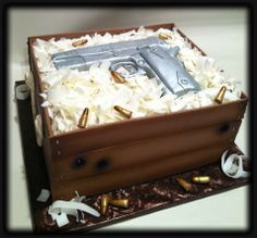kimber handgun grooms cake - The gun is all edible. The shavings are chocolate. The bullets are made from gumpaste. The bullet holes were and extra touch. I wanted to put caution just married but thought I really don't know the couple to thought I better not. HaHa