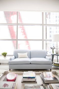 City style: Love the contrast of this pale blue English roll arm sofa against the urban-loft city background.
