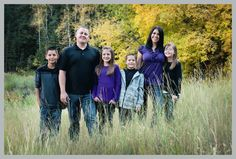 family standing in tall mountain grass up American Fork Canyon, family photo, great colors