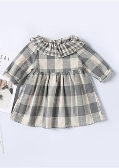 The Sophie dress is a gorgeous mix of plaids. With the ruffle collar and the buttons down the back this little cotton blend dress is a classic. Pair it with the Ella Leggings and the Avery Oxford.