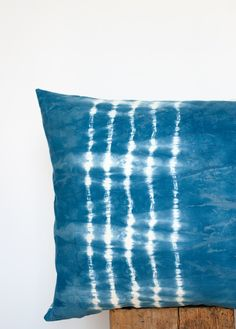 Learn how to hand dye fabric with indigo using the shibori technique & then turn your creation into gorgeous pillows!