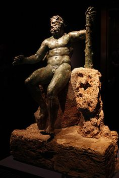 "Hercules (Heracles) (""Epitrapeizos""), Roman statue (bronze) modelled after Lysippus, 1st century AD (original 4th c. BC), (Museo Archeologico Nazionale, Naples)."