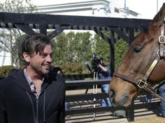 Actor Skeet Ulrich has a little fun with Derby winner Mine That Bird at the Kentucky Derby Museum