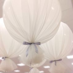 Giant balloons with tulle and ribbon for a wedding
