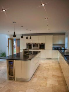 Shiny white kitchen, natural tiles