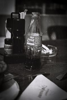 Photography by SP Kirilov: bottle of Coke Lens - industar 50-2 Film - ORWO NP22, expired in 1981 Process - D-76 at 21 C degree. Cinema Camera, Lomography, Coke, Whiskey Bottle, Black And White Photography, Canon Eos, Cameras, Lens, Black White Photography