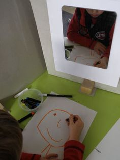 Mirror- Drawing center for self-portraits. i compiled it into a book at the end of the year and titled it watch me grow with a pic of the kid from the first day and the last week.