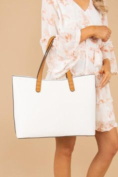 This purse is so chic and sleek! The color is so crisp and we love the classic design! You can shop this purse at the Mint Julep Boutique! Victoria Secret Swimwear, Mint Julep Boutique, Handbags Online Shopping, Indian Embroidery, White Purses, Prada Handbags, Ivory White, Night Outfits, Michael Kors Jet Set