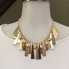 Chicos necklace This is a fun gold necklace to have, never worn Chico's Jewelry Necklaces