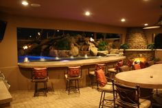 Bar stools and concrete swim up bar in ramada