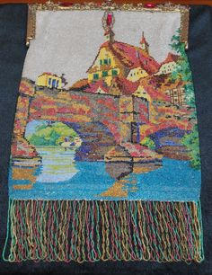 Captivating bead knit scene of a German town, complete with river and bridge in extraordinary colors captured by the skilled bead knitter. This bag has all the bells and whistles making it a fabulous find for the savvy advanced collector. A jeweled frame with faceted different sized glass stones compliments the bag nicely