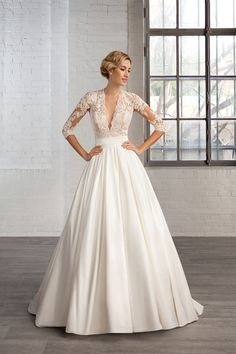 This wedding gown has sheer sleeves down to the elbow.The pretty lace bodice compliments the full a-line style skirt. Elegant #weddingdresses like this can be made to order with any preferences the bride needs. You can also obtain very similar #replicas of couture bridal gowns that are less than the original. Contact us directly for pricing on any dress at www.dariuscordell.com