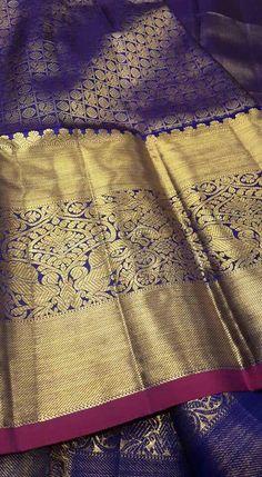 Kanjeevaram silk saree with big zari border. South Indian fashion.