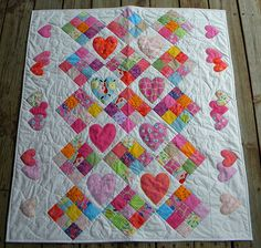 | Flickr - Photo Sharing! No pattern but pretty easy to follow-9 sq. blocks, plain blocks appliqued with hearts, laid out on the diagonal with hearts as quilting motif in borders. Fantastic baby/toddler quilt.