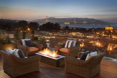The roof deck includes a glass railing, fire pit and unobstructed views of the Palace of Fine Arts and the Golden Gate Bridge. Photo: Paul D...