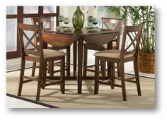 Friendship Series Pub Set: High Table with drop leaf, turns into a round table; drop leaf enables the table to be easily fit into a corner or by the wall.
