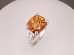 For November babies! Gorgeous Imperial topaz ring with diamond prongs.